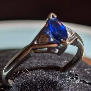 14k white gold and blue stone  two small diamonds
